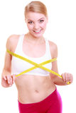 Fitness woman fit girl with measure tape measuring her bust. Time for diet slimming weight loss. Health care and healthy nutrition. Young fitness woman fit girl Royalty Free Stock Image