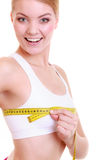 Fitness woman fit girl with measure tape measuring her bust. Time for diet slimming weight loss. Health care and healthy nutrition. Young fitness woman fit girl Stock Image