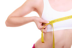 Fitness woman fit girl with measure tape measuring her bust. Time for diet slimming weight loss. Health care and healthy nutrition. Young fitness woman fit girl Stock Photo