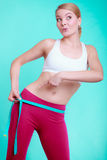 Fitness woman fit girl with measure tape measuring her loins Stock Image