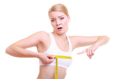 Fitness woman fit sad girl with measure tape measuring bust. Time for diet slimming weight loss. Health care and healthy nutrition. Young fitness sad woman fit Royalty Free Stock Image