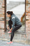 Fitness woman getting ready for outdoor workout Royalty Free Stock Photos