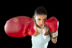 Fitness woman with girl red boxing gloves posing in defiant and competitive fight attitude Royalty Free Stock Photos