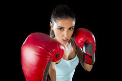 Fitness woman with girl red boxing gloves posing in defiant and competitive fight attitude Stock Photography
