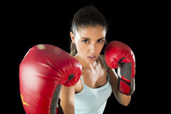 Fitness woman with girl red boxing gloves posing in defiant and competitive fight attitude Stock Image