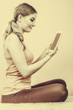 Fitness woman girl with tablet browsing internet. Royalty Free Stock Photos