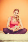 Fitness woman girl with tablet browsing internet. Young woman using computer tablet browsing internet. Fitness sporty girl holding ebook. Technology leisure Stock Image
