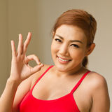 Fitness woman giving ok hand sign Royalty Free Stock Images