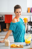 Fitness woman with glass of pumpkin smoothie Royalty Free Stock Image