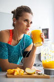 Fitness woman with glass of pumpkin smoothie Royalty Free Stock Photos