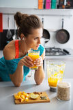 Fitness woman with glass of pumpkin smoothie Stock Images