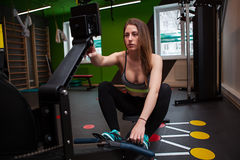 Fitness woman in gym in gym Stock Images