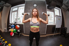 Fitness woman in gym in gym Royalty Free Stock Photography