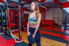 Fitness woman in gym in gym Royalty Free Stock Photos