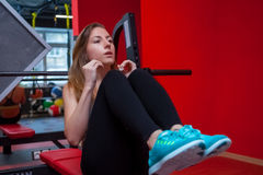 Fitness woman in gym in gym Stock Photos