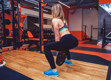 Fitness woman in gym in gym Stock Photography