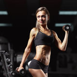 Fitness woman in the gym Royalty Free Stock Photo
