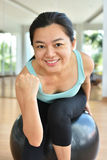 Fitness woman in gym Stock Images