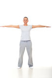 Fitness woman with hands well stretched Royalty Free Stock Images