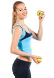 Fitness woman happy smiling holding green apple Stock Image