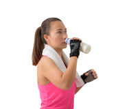 Fitness woman happy smiling holding milk bottle and drinking mil Royalty Free Stock Photo