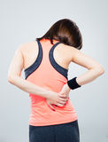 Fitness woman having back pain Stock Photo