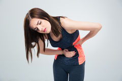 Fitness woman having pain in stomach Royalty Free Stock Image