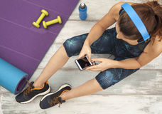 Fitness woman headphone in home Royalty Free Stock Images