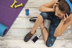 Fitness woman headphone in home Royalty Free Stock Image