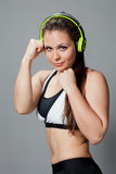 Fitness woman with headphones Stock Image
