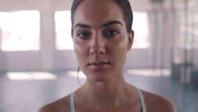 Fitness woman in health club. Close up of fitness woman in health club. Beautiful female at gym staring at camera after workout stock video footage