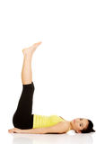 Fitness woman with her legs up. Royalty Free Stock Photo