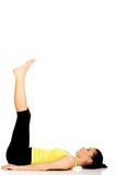 Fitness woman with her legs up. Stock Photos
