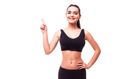 Fitness woman hold hand showing something on the open palm. Young slim Fitness woman hold hand showing something on the open palm, concept advertisement product royalty free stock photos
