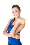 Fitness woman holding apple Stock Photos
