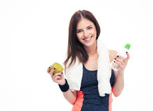 Fitness woman holding apple and bottle with water Stock Photography