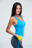 Fitness woman holding apple and measuring tape Royalty Free Stock Photos