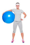 Fitness woman holding big ball Royalty Free Stock Image