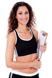 Fitness woman holding a blank clip board Royalty Free Stock Image