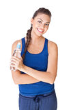 Fitness woman holding bottle of water isolated on white Royalty Free Stock Photos