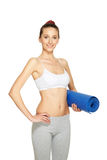 Fitness woman holding mat Stock Photography