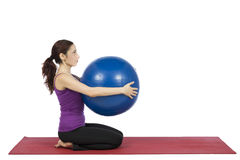 Fitness woman holding a pilates ball royalty free stock image