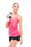 Fitness woman holding sports bottle Stock Photography