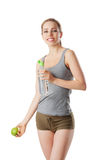 Fitness woman holding water bottle and green apple. Isolated on white Royalty Free Stock Image