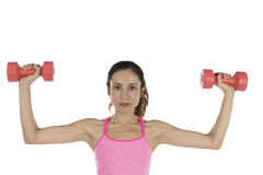 Fitness woman holding weights isolated on white background Stock Photography