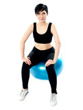 Fitness woman isolated sitting on pilate ball Royalty Free Stock Photo
