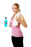 Fitness woman with isotonic drink and ok sign. Attractive woman in fitness clothes with isotonic drink and ok sign Stock Photography