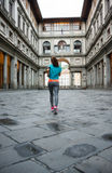 Fitness woman jogging near uffizi gallery in florence, italy. re. Ar view Stock Photography