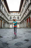 Fitness woman jogging near uffizi gallery in italy. Fitness woman jogging near uffizi gallery in florence, italy Stock Image