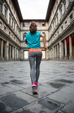 Fitness woman jogging near uffizi gallery in italy. Fitness woman jogging near uffizi gallery in florence, italy. rear view Royalty Free Stock Photos
